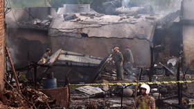 Pakistani military plane crashes in residential area, killing 17 as fire engulfs crash site