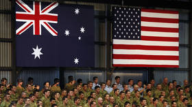FILE PHOTO: American and Australian troops listen to an address by then-President Barack Obama at a base in Darwin in 2011 © Reuters / Larry Downing