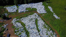 THOUSANDS of unopened bottles of water meant for Puerto Rico hurricane victims found in field… AGAIN