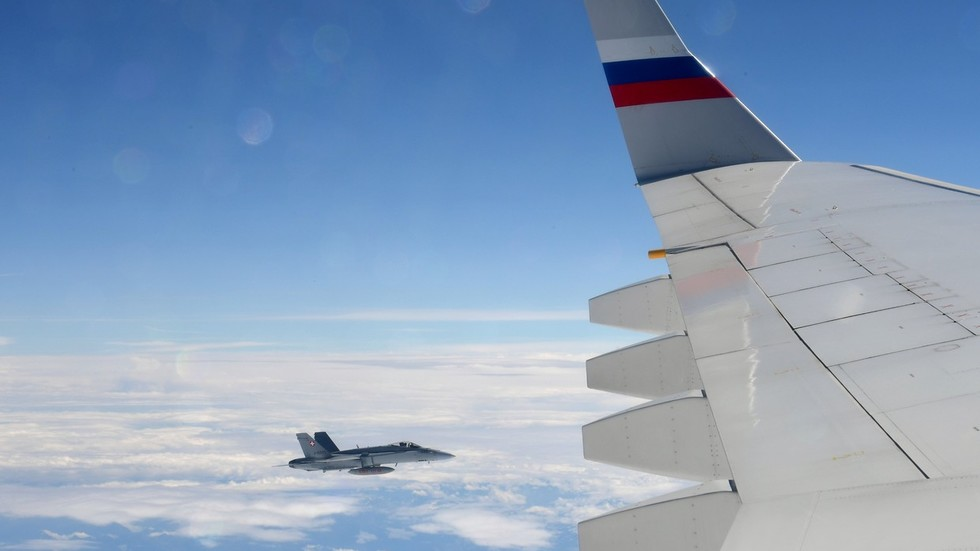 Watch Swiss fighter jets shadow Russian GOVERNMENT PLANE as 'act of hospitality'