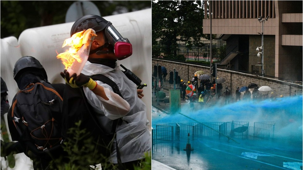 Hong Kong police turn to water cannon as protesters hurl petrol bombs & bricks (PHOTO, VIDEO)