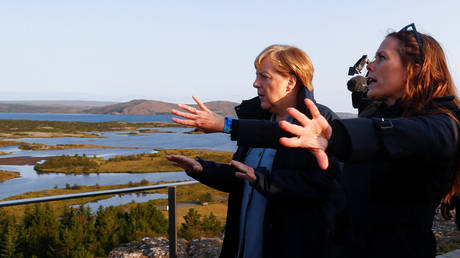 Irish border solution possible, but not by reopening withdrawal deal, Merkel says
