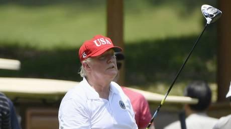 US President Donald Trump playing golf. File photo