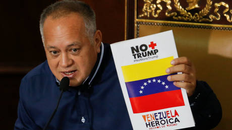 Venezuela's National Constituent Assembly President Diosdado Cabello holds up an anti-Trump pamphlet during a session, August 12, 2019.