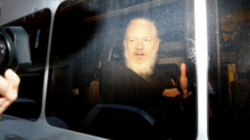 Assange being 'treated worse than a murderer' in prison – John Pilger