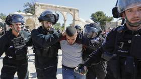 Israeli forces use tear gas in clashes with Palestinian worshipers at Temple Mount