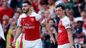 Two men charged over 'security incident' involving Arsenal's Ozil and Kolasinac