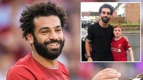 Mo Salah poses with young fan who broke his nose trying to greet Liverpool star (PHOTOS)
