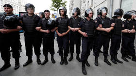 Moscow woman seeks charges against police officer who 'punched her' during protest