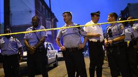 Philadelphia shooter surrenders after hours-long standoff with police