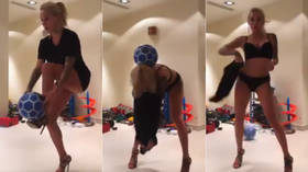 Wife of Ukrainian footballer shows off incredible ball trick while undressing (VIDEO)
