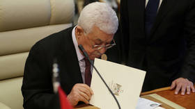 Palestinian President Abbas fires all advisers amid West Bank financial crisis