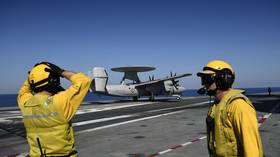 Oops! Turboprop plane hits 4 Hornet jets amid bumpy landing on USS Abraham Lincoln (VIDEO)