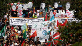 Protesters 'greet' G7 leaders, French police fires tear gas