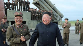 He does love missiles! Smiling Kim tests N. Korea's 'super-large multiple rocket launcher' (PHOTOS)