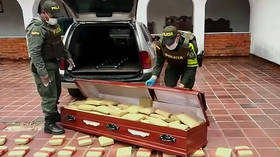 Can't take it with you: Colombian cops find 300kg of cannabis INSIDE coffins (VIDEO)