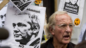 'His psychological torture is unabated': John Pilger reveals Assange prison conditions