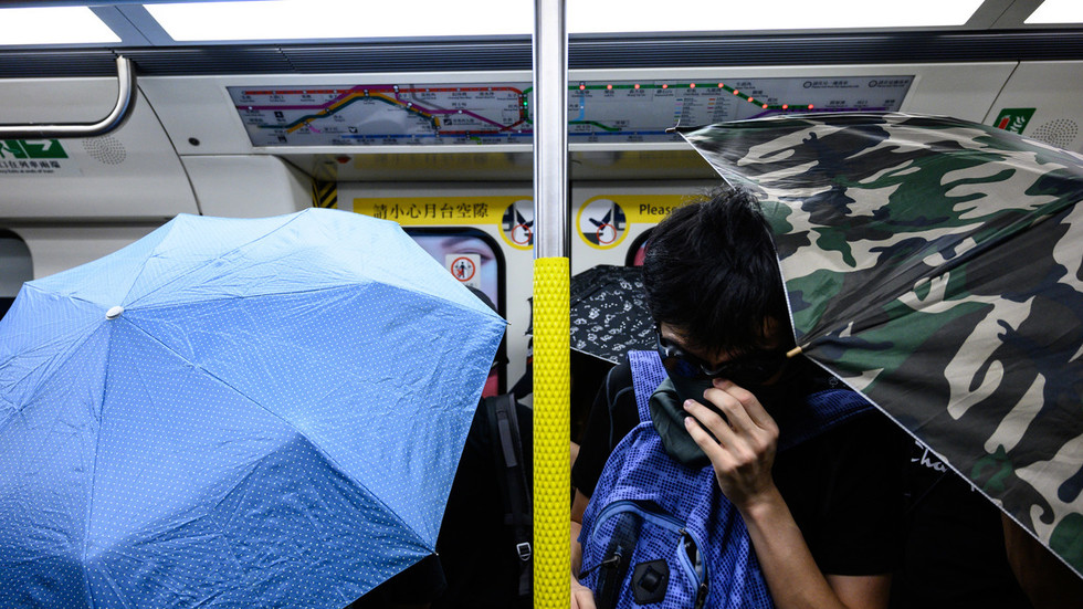 Four 'uncles' face off against swarm of armed protesters in Hong Kong metro