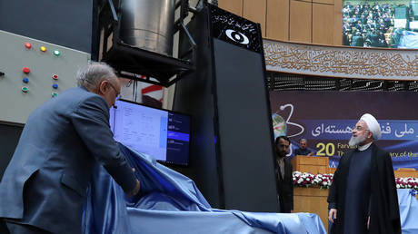 "FILE PHOTO Iranian President Hassan Rouhani (R) and Iran's nuclear technology organisation Ali Akbar Salehi (L) during the ""nuclear technology day"" © AFP / HO / Iranian Presidency"