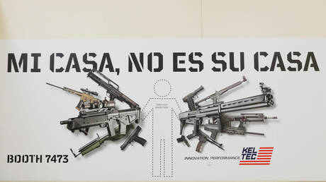 FILE PHOTO: An ad for an arms manufacturer at the NRA annual convention.