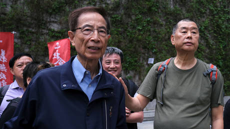 FILE PHOTO: Hong Kong politician Martin Lee and Founder of Next Media Jimmy Lai march during a protest to demand authorities scrap a proposed extradition bill with China, in Hong Kong, China, on March 31, 2019.