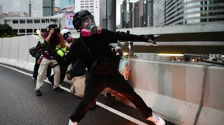 A protester throws a molotov cocktail towards police in the Admiralty area of Hong Kong on August 31, 2019. В© AFP / Anthony Wallace