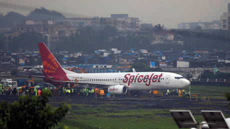 A SpiceJet passenger aircraft Boeing 737 is seen at the airport in Mumbai, India. File photo.
