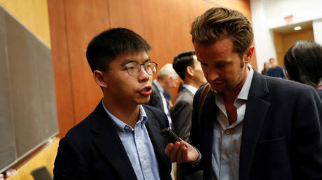 Hong Kong's pro-democracy activist Joshua Wong speaks to a reporter after a panel discussion on Anti-Extradition Law Movement in Hong Kong at Columbia University Law School in New York City, U.S., September 13, 2019. © REUTERS/Shannon Stapleton