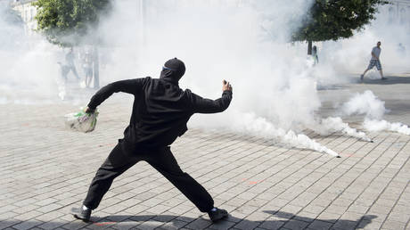 A protester throws a projectile during clashes with police during anti-government demonstration in Nantes, France on September 14, 2019.
