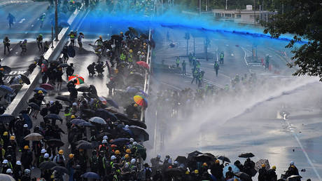 Police use water cannons on protesters outside the government headquarters in Hong Kong, China on September 15, 2019.