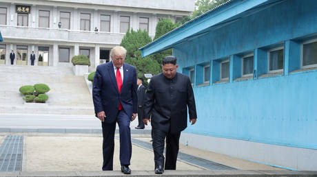 FILE PHOTO: Donald Trump and Kim Jong Un cross over a demarcation line at the demilitarized zone (DMZ) on June 30, 2019 © KCNA via REUTERS