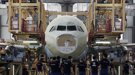 Employees work at the Airbus Tianjin assembly plant in Tianjin municipality, China. File photo