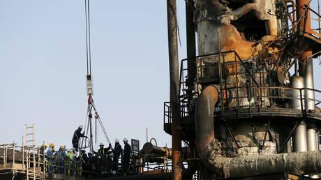 Workmen repairing the Saudi Aramco oil facility in Abqaiq, Saudi Arabia, September 20, 2019.