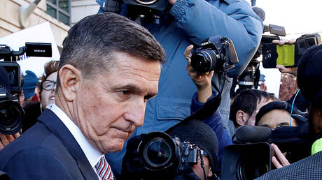 Former US national security adviser Michael Flynn departs US District Court in Washington, DC (file photo)