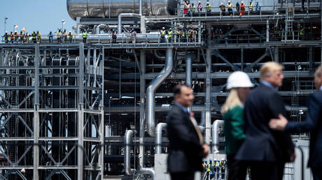 Workers watch as US President Donald Trump tours the Cameron LNG Export Facility May 14, 2019, in Hackberry, Louisiana.