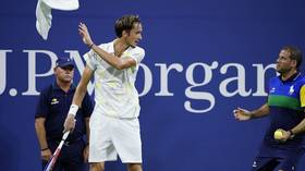 Russia's Medvedev fined after ball-boy antics, middle-finger gesture in fiesty US Open 3rd-round win