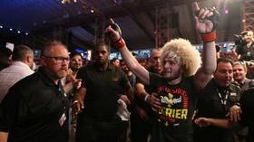 Poirier UFC shirt worn by Khabib raises $100K for charity