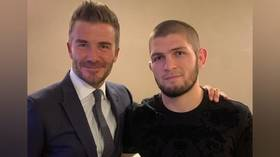 Bumping into Beckham: UFC champ Khabib meets England legend at PSG-Real Champions League game