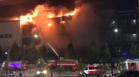 ENORMOUS fire consumes Chechnya's largest shopping mall as customers FLEE in terrifying VIDEOS