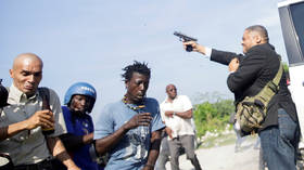 Haitian senator shoots photographer in the FACE amid political chaos in Port-au-Prince (VIDEO)