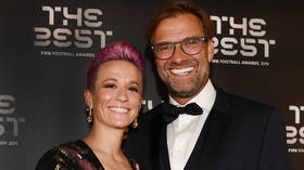 'He's taking no chances!' Klopp's awkward 'hover hand' moment with Rapinoe at glitzy FIFA bash sets off social media