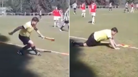 They see me rolling: Drunk Czech linesman sways & sprawls near pitch while officiating youth football game (VIDEO)