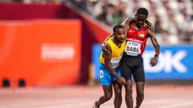 WATCH: Heartwarming scenes as runner helps stricken rival stagger across the line at World Athletics Championships in Doha