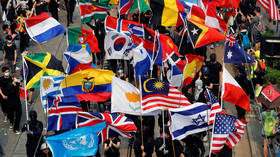 Hong Kong protesters add more foreign flags to their arsenal, including... East Timor & Papua New Guinea (VIDEOS)