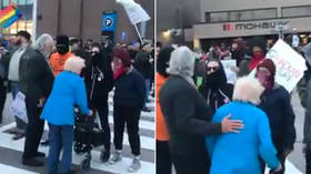 Shock and outrage as masked Antifa crowd blocks and shouts at elderly couple in Canada (VIDEO)