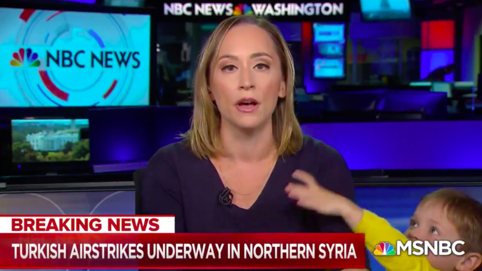 Child's play: Reporter's breaking news broadcast interrupted by small screen debut of her toddler