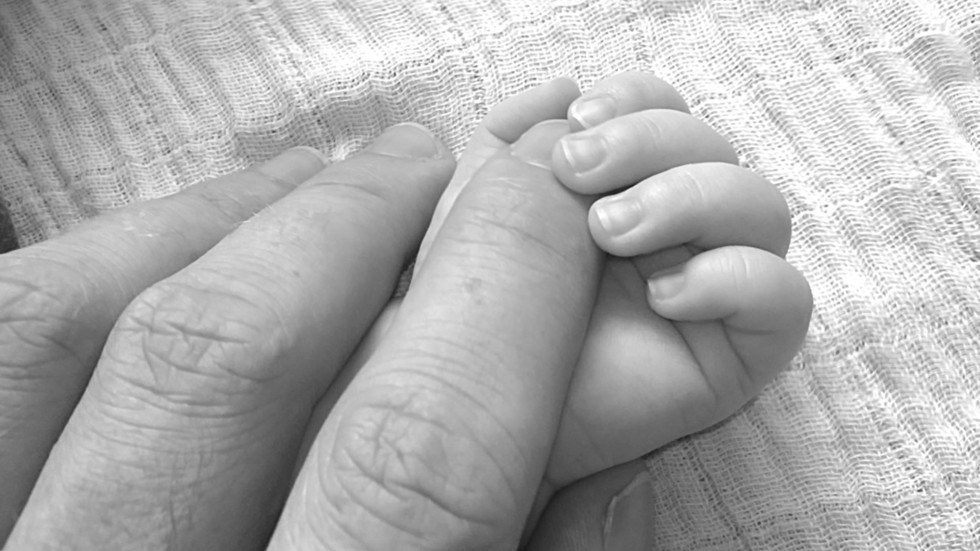 Grieving father finds another newborn alive in shallow grave while burying his own daughter