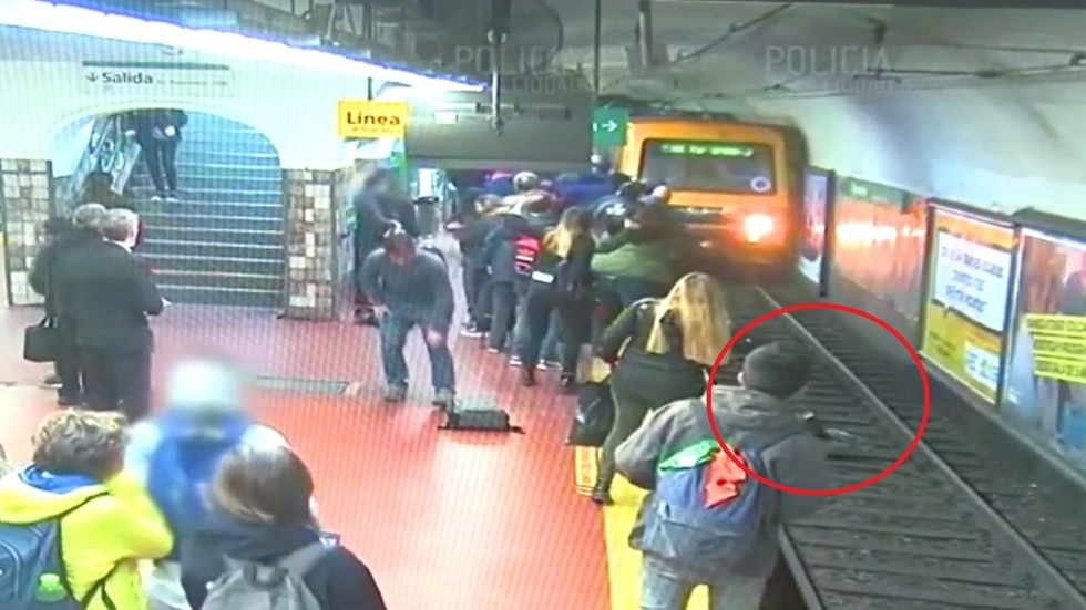 WATCH: Buenos Aires commuters stage frantic rescue after woman KNOCKED onto metro tracks