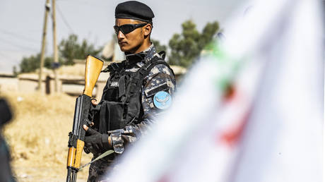 A member of the Kurdish Internal Security Police Force of Asayesh stands guard during a demonstration by Syrian Kurds against Turkish threats to launch a military operation on their region, in the town of Al-Qahtaniyah, in northeastern Syrian Al-Hasakah Governorate on October 7, 2019.