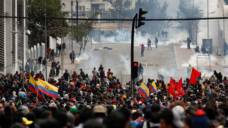 Demonstrators clash with police officers during a protest against austerity measures in Quito, Ecuador on October 8, 2019.